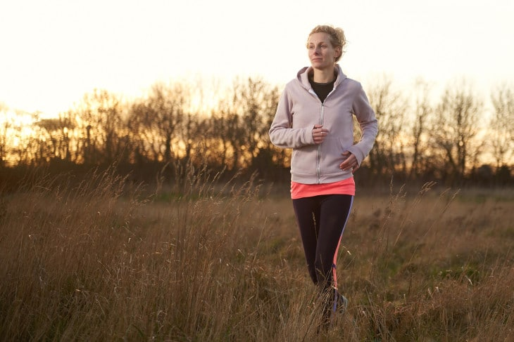 Girl running in the fields