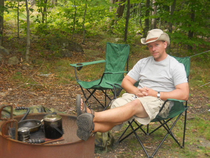 Man wearing boonie camping