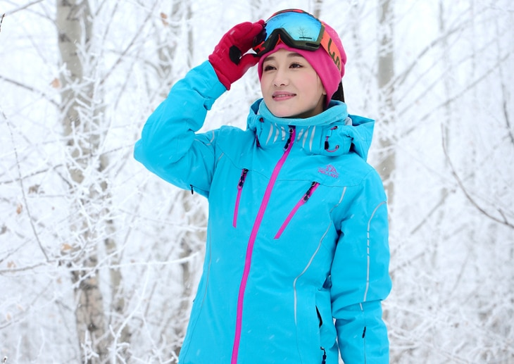 Pink and teal snowboard attire