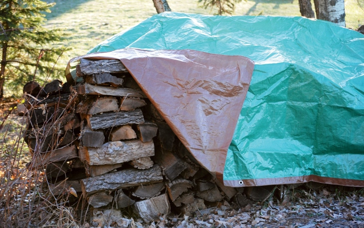 Tarp covering firewoods