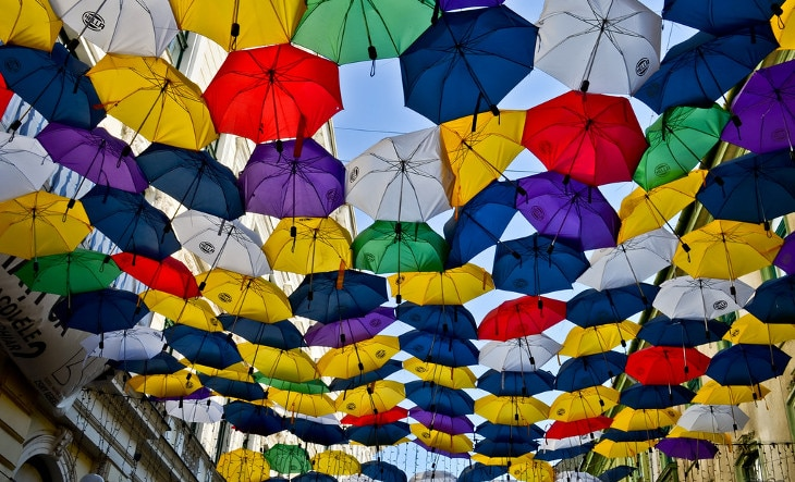 Umbrellas hanging above street