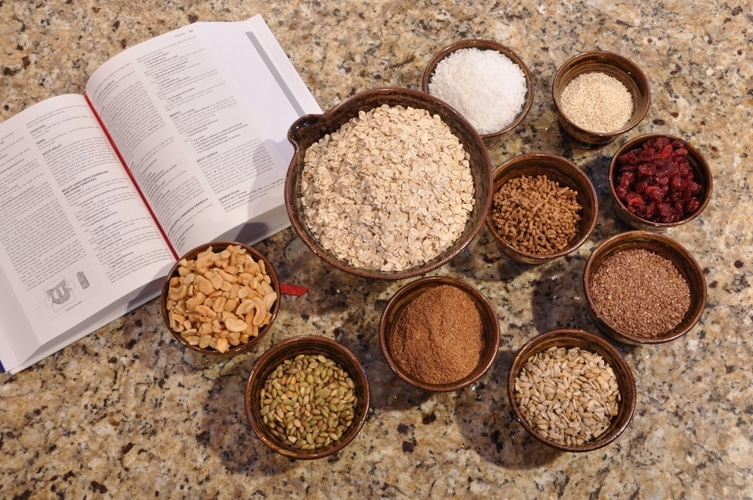 Open recipe book with cooking ingredients for energy bars