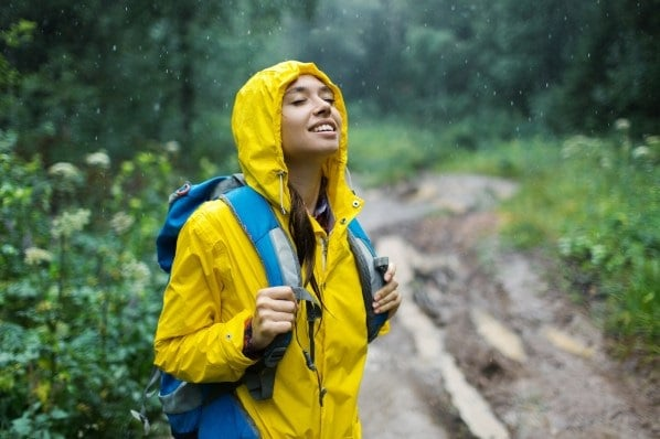 Woman hiker hiking in rain forest