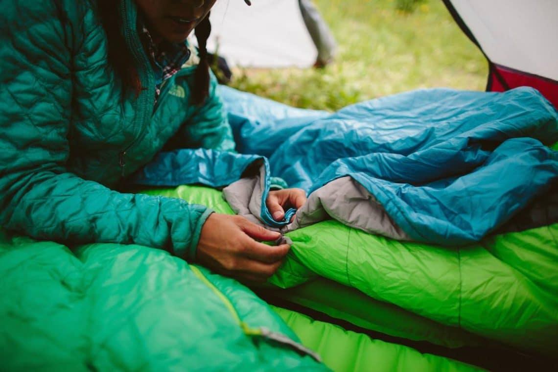 a girl inside of sleeping bag