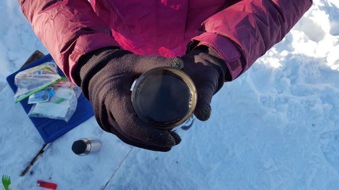 hiker drinking tea in the winter