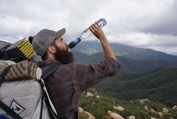 hiker hydrating himself