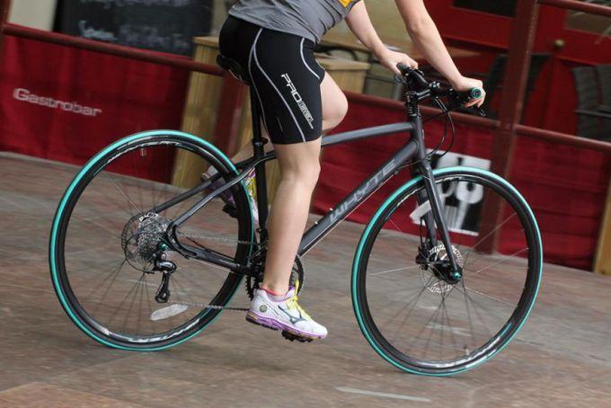 man riding a hybrid bike