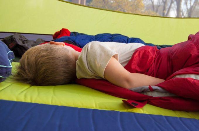 baby sleeping in tent