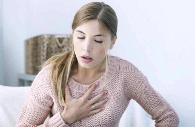 Girl having a breathing problem