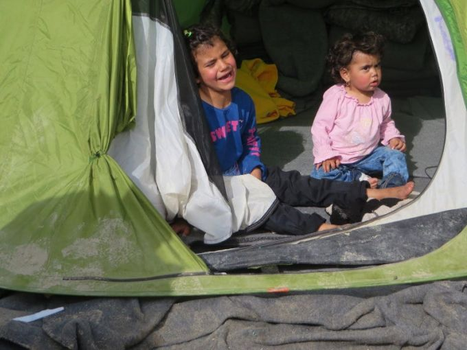 baby and her sister crying in tent