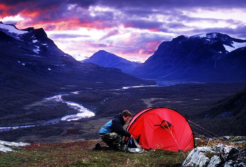 Man camping alone in the mountains