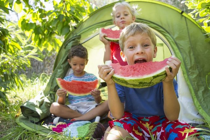 kids eating watermelon slices