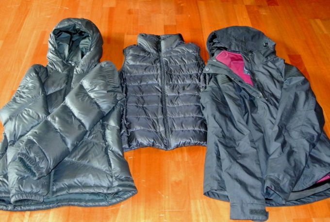 preparing extra layers of clothing for hiking