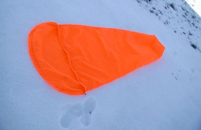 orange sleeping bag liner on the snow