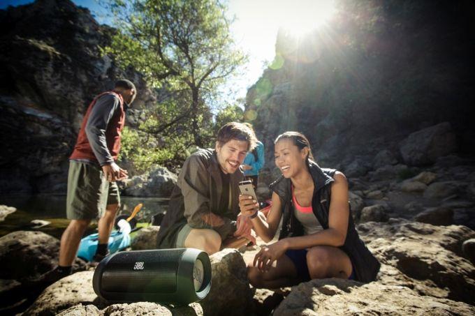 hikers listening music on speaker