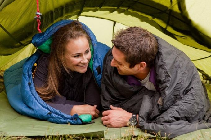 man and woman in their sleeping bags