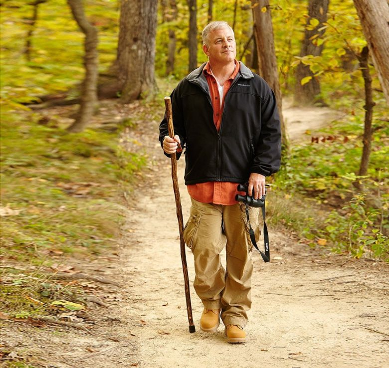 man walking with a stick