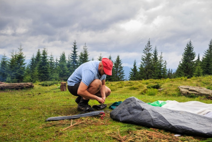 Man packing up his tent