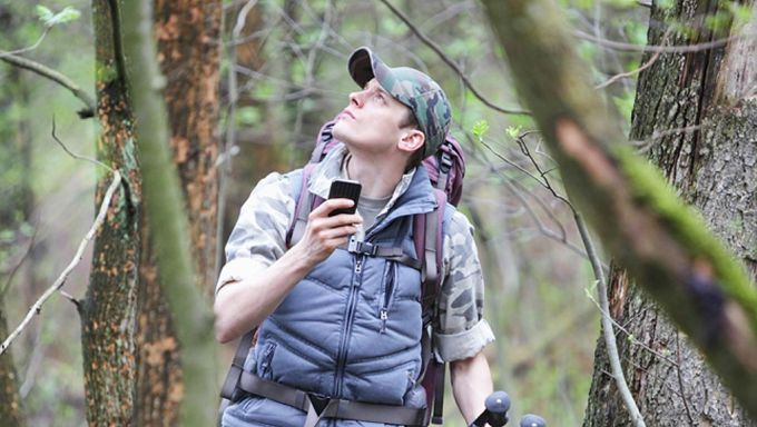 hiker trying to get phone reception
