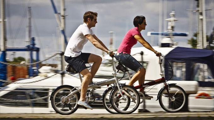 couple riding folding bikes