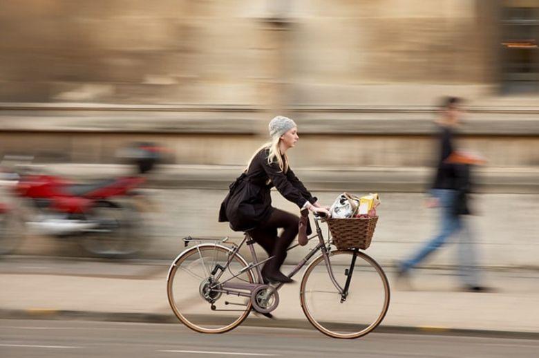 girl riding a city bike