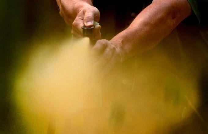 man spraying a bear spray