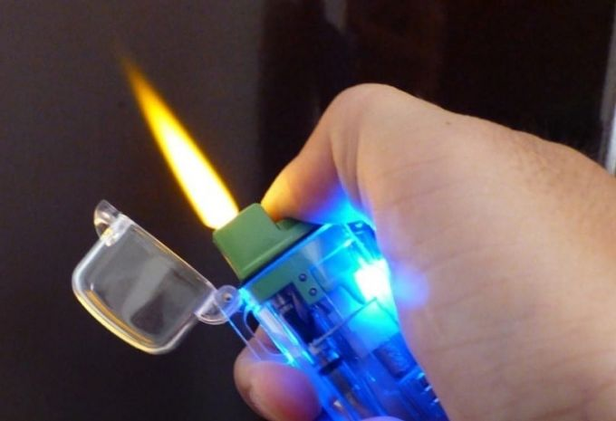 survival lighter with flashlight