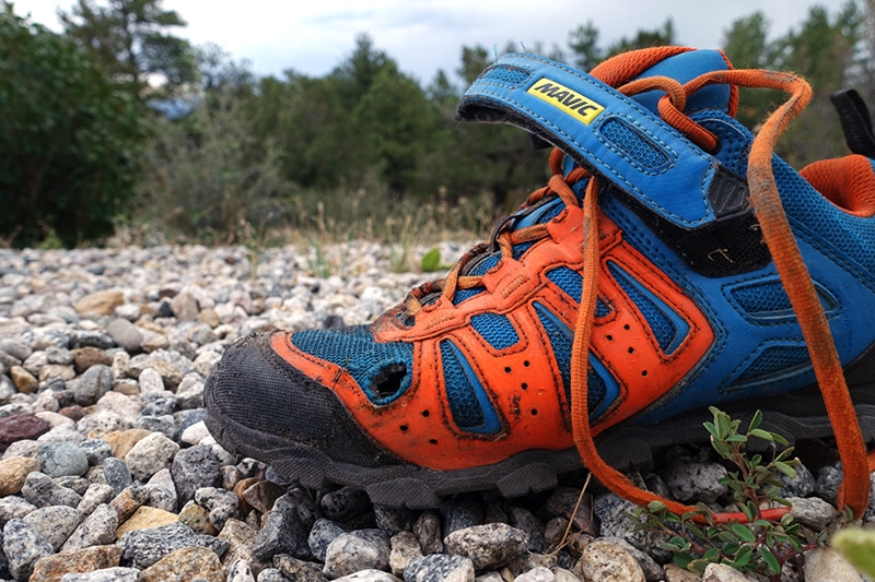 torn hiking shoes