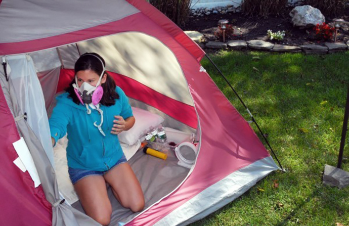 wearing mask while cleaning tent