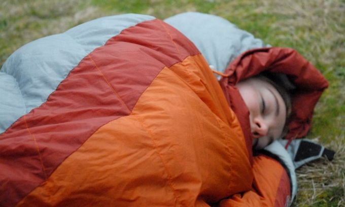 Curled up in sleeping bag