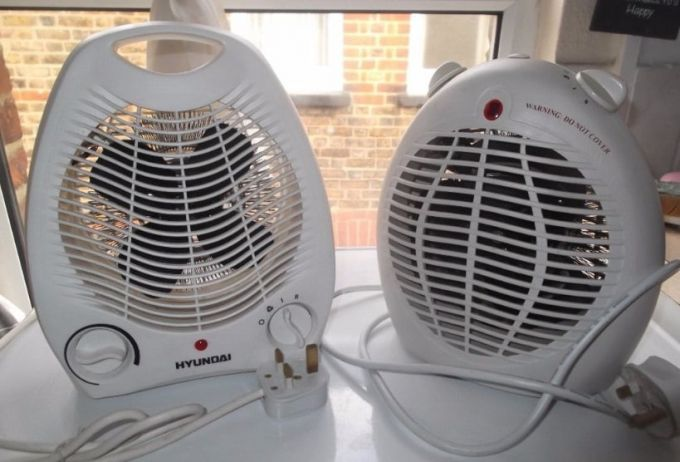 Two small portable fan heaters