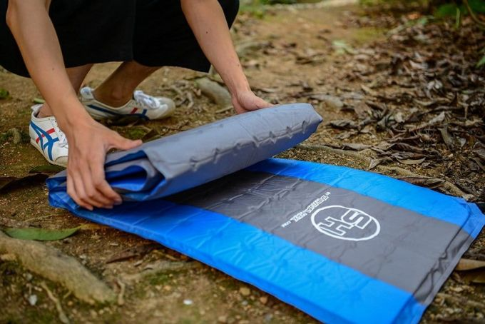 rolling an self inflating sleeping pad