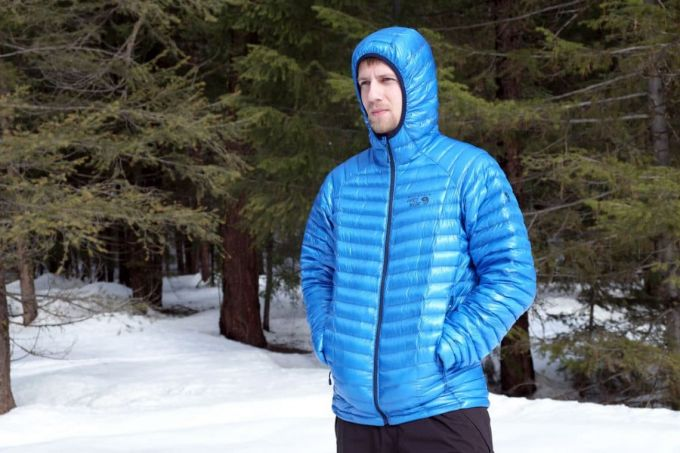 man wearing blue jacket with hood