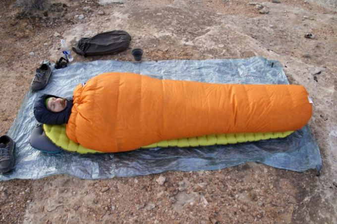 man on sleeping bag