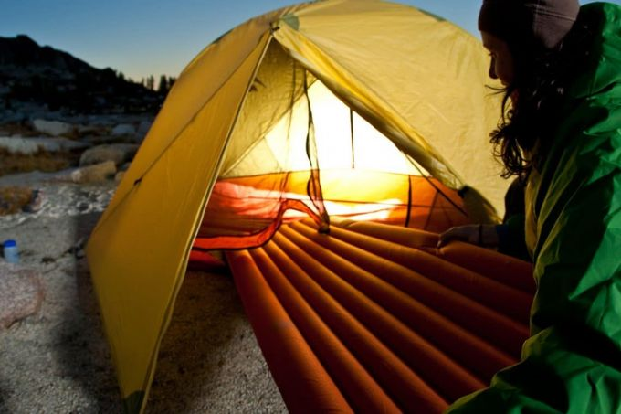 inserting sleeping pad into tent