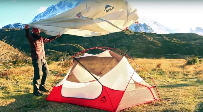 setting up tent in flat ground