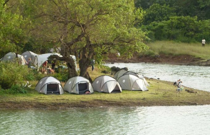 setting up tent near water