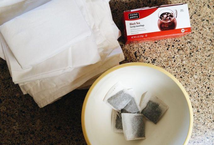 box of black tea and tea bags