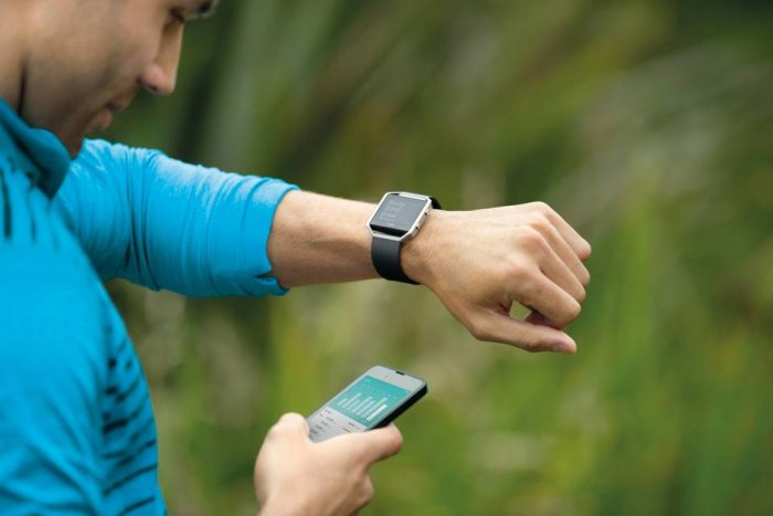 Image showing a man looking at his Smart Fitness Watch