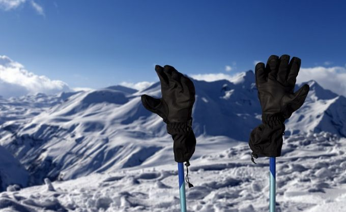 A pair of-Ski-Gloves and a moutains landscape