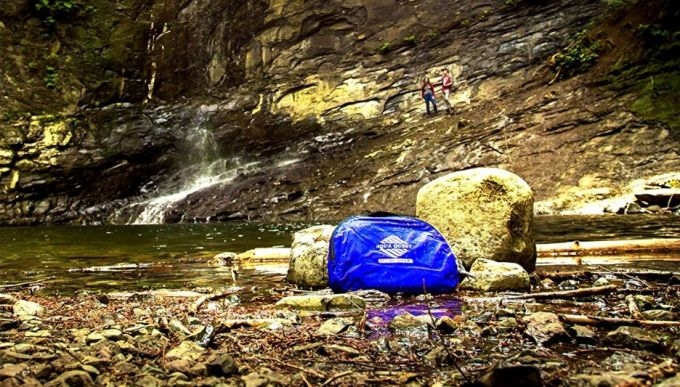 waterproof backpack near lake
