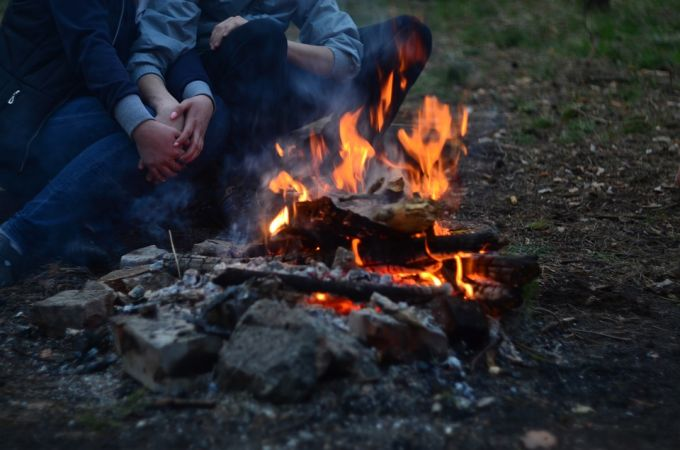 People Sitting Next to Campfire